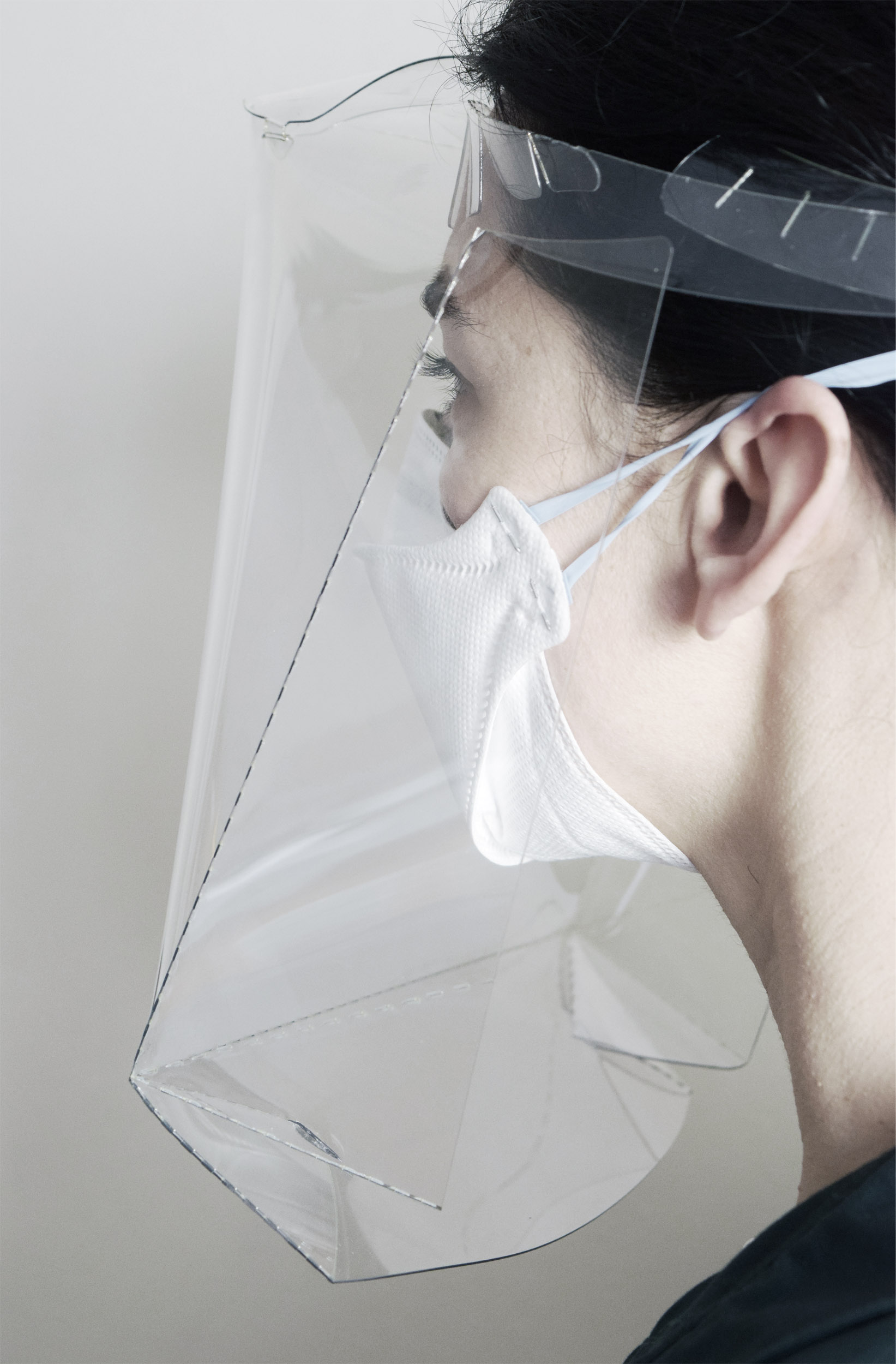 Woman wearing face shield mask side close up