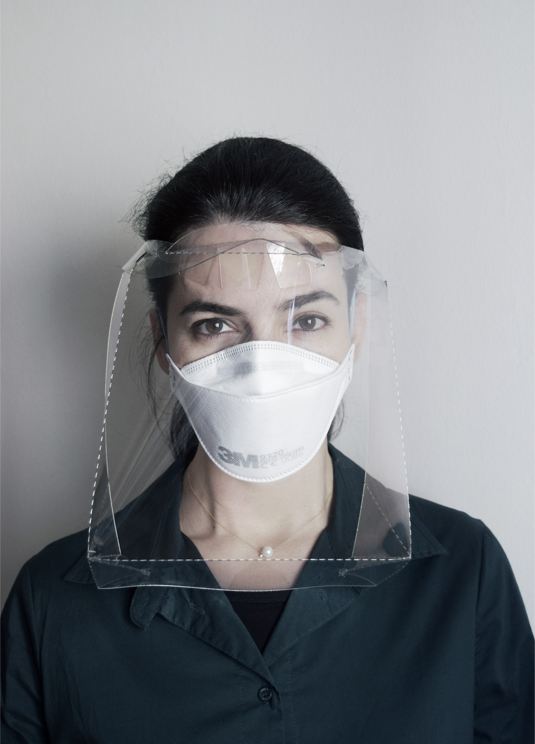Woman wearing face shield mask front side